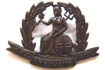 Gresham School OTC cap badge